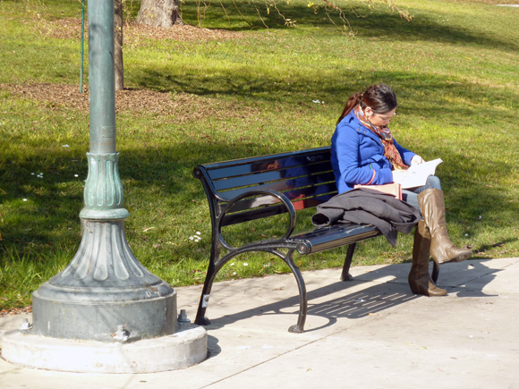 Woman reading near the Lake Chalet.